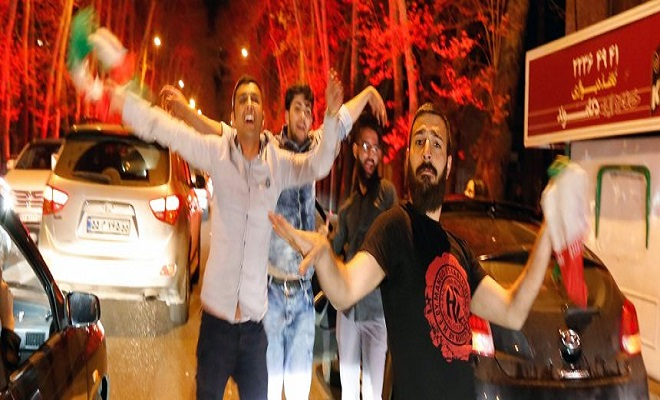 Iranians celebrate after nuclear talks in the street of Tehran