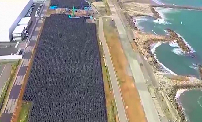 Black-plastic-bags-storing-nuclear-waste-at-Fukushima.-Screen-shot-from-Ruptly-video.-e1429444437974